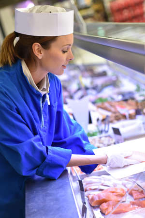fish shop: Fishmonger woman at work Stock Photo