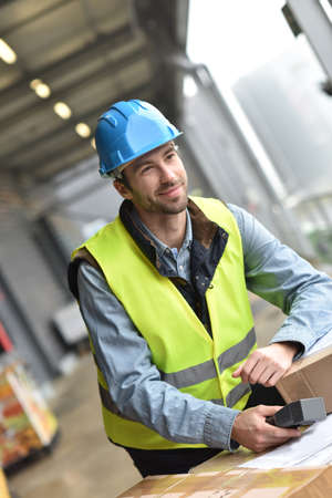 warehouseman: Portrait of warehouseman scanning merchandise on dock Stock Photo