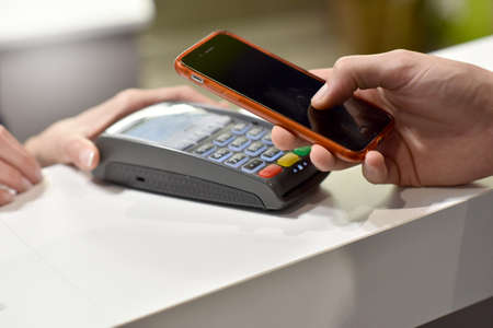 near: Direct payment with smartphone, Near field communication Stock Photo
