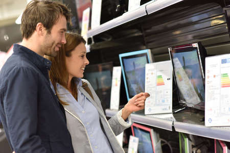 television set: Couple in department store choosing television set