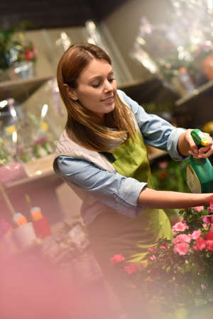 woman shop: Woman working in flower shop Stock Photo