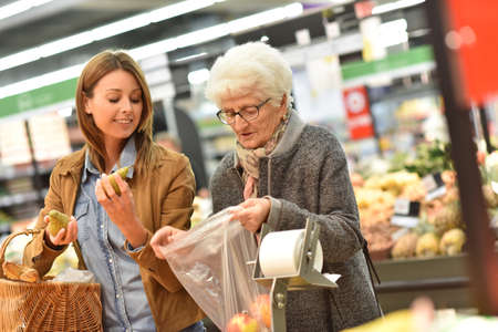 70 80 years: Elderly woman with young woman at the grocery store