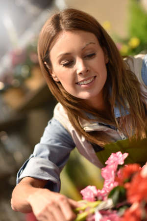 selling service smile: Woman working in flower shop Stock Photo