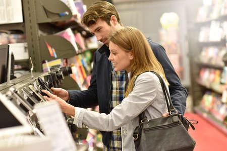 choosing: Couple in department store choosing smartphone Stock Photo