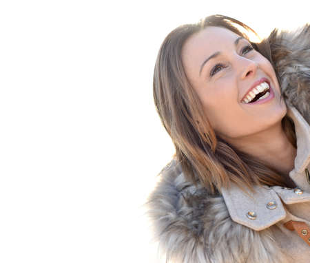 30 years old woman: Portrait of cheerful girl with winter coat and fur hood Stock Photo