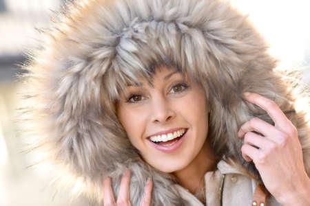 fur hood: Portrait of beautiful woman with winter coat and fur hood