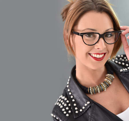30 years old woman: Beautiful trendy woman with eyeglasses, grey background