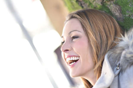 woman profile: Profile view of young woman laughing outloud Stock Photo