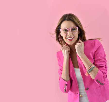 Cheerful girl wearing eyeglasses, pink color Stock Photo