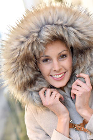 30 to 35 years old: Portrait of beautiful woman with winter coat and fur hood