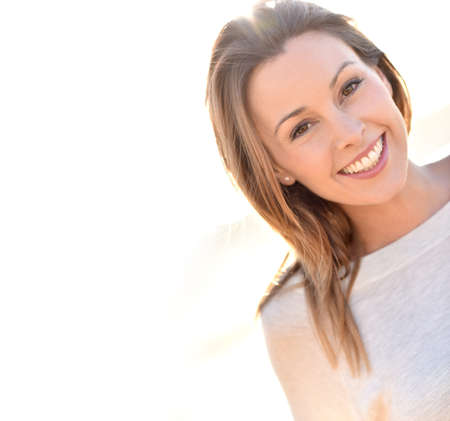 30 to 35 years old: Portrait of cheerful natural woman with long hair
