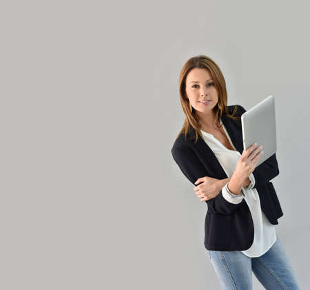 30 years old woman: Beautiful woman using tablet, grey background