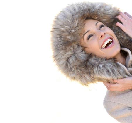 fur hood: Portrait of cheerful girl with winter coat and fur hood Stock Photo