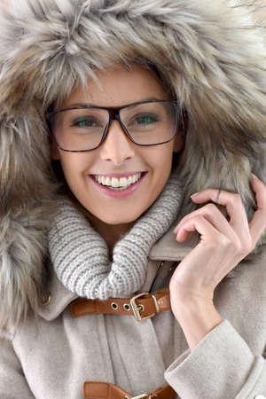fur: Closeup of woman wearing fur hood, isolated