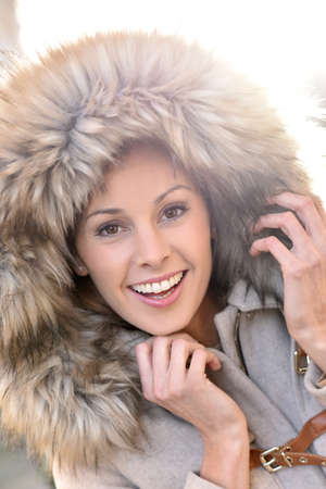 fur: Portrait of beautiful woman with winter coat and fur hood