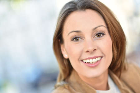 30 to 35 years old: Portrait of beautiful brunette woman in city street