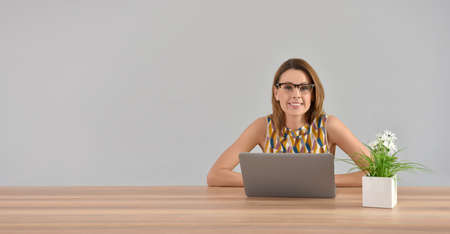 working woman: Beautiful woman working on laptop, isolated