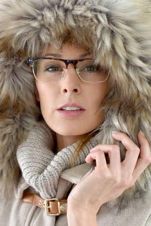 30 years old woman: Closeup of woman wearing fur hood, isolated