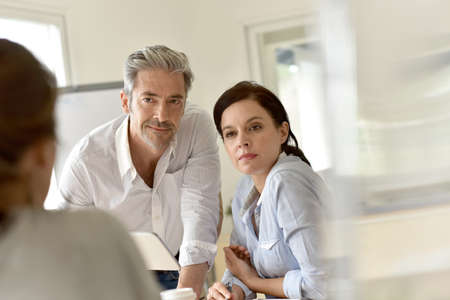 business finance: Business people meeting around table with partners