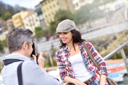 couples outdoors: Man taking picture of girlfriend, week-end travel Stock Photo