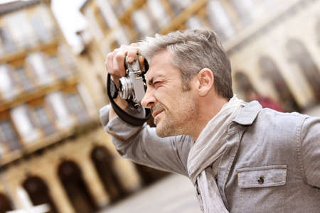 visitors area: Man taking pictures on travel journey
