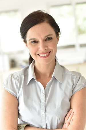 old women: Portrait of smiling 40-year-old business woman