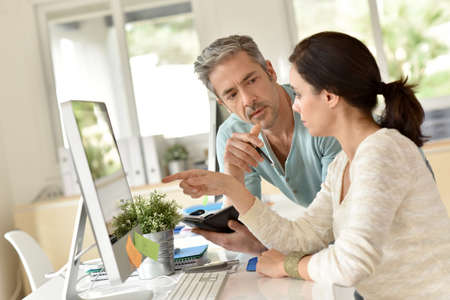 business project: Co-workers planning business project together Stock Photo