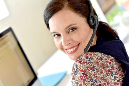 hot line: Portrait of smiling customer service operator Stock Photo