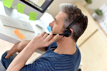 telemarketing: Closeup of telemarketing worker in office Stock Photo