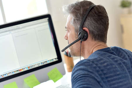 business man phone: Closeup of telemarketing worker in office Stock Photo