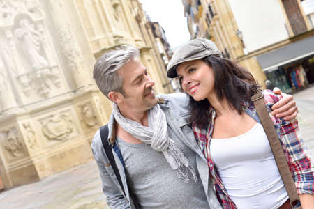 quarter: Tourists walking in historical quarter of spanish town Stock Photo