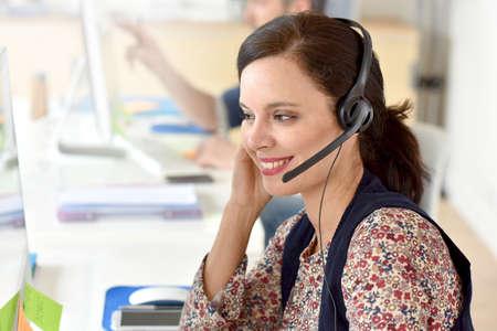 telephone headset: Portrait of smiling customer service operator Stock Photo