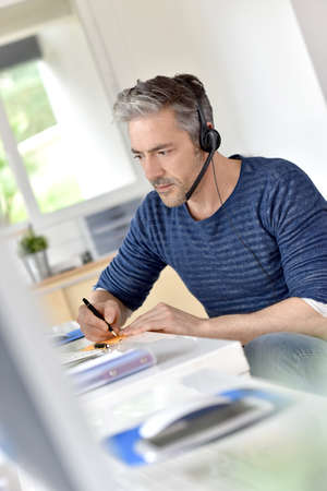 teleoperator: Businessman in office using phone headset