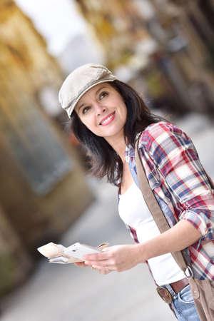 visiting: Trendy girl visiting Europe, travel tour Stock Photo