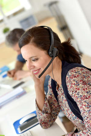 phonecall: Portrait of smiling customer service operator Stock Photo