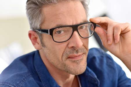 mature man: Portrait of handsome mature man with eyeglasses