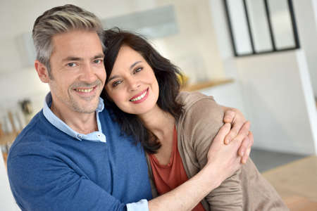 Middle-aged couple embracing each other Stock Photo