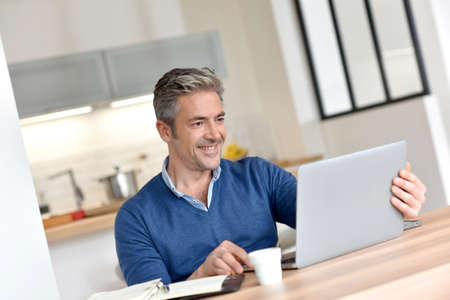 homeoffice: Man working from home-office with laptop computer