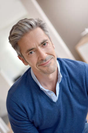 40 to 45 years old: Portrait of smiling handsome man with grey hair