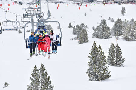 chairlift: Family at ski resort sitting in chairlift