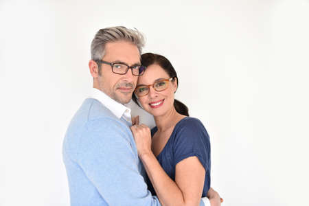 40 to 45 years old: Middle-aged couple with eyeglasses on white background