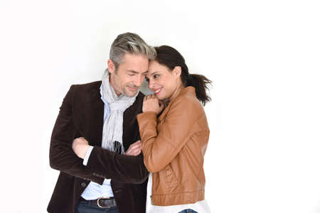 Middle-aged couple standing on white background Stock Photo