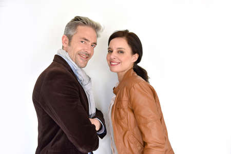 45 years old: Middle-aged couple standing on white background Stock Photo