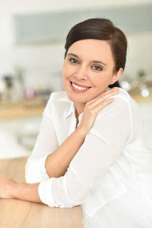 casual attire: Portrait of attractive 40-year-old woman at home