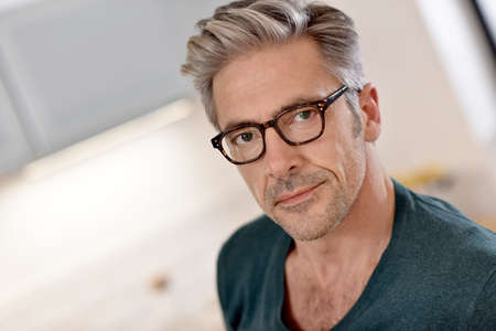 man with glasses: Portrait of handsome mature man with eyeglasses