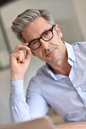 45: Portrait of handsome businessman with eyeglasses