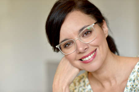 woman  glasses: Portrait of smiling middle-aged woman with eyeglasses