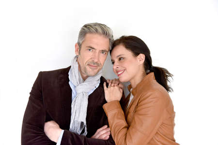 40 45: Middle-aged couple standing on white background Stock Photo