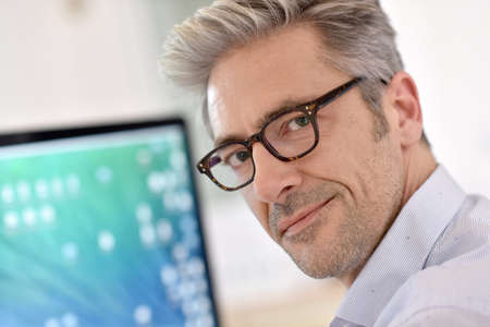 40 to 45 years old: Portrait of handsome businessman with eyeglasses
