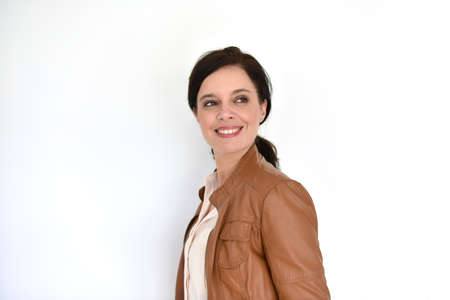 45 years old: Smiling attractive brunette woman on white background